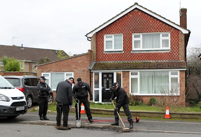 Police and forensic specialist teams have set up a blue tent and are still investigating at the four-bedroom detached property (SWNS)