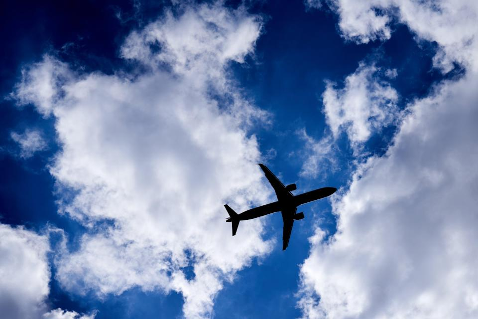 A silhouette of a plane as it passes overhead in Isleworth, West London (PA Archive)