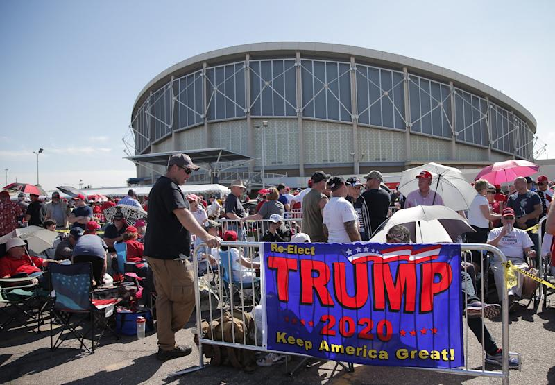 Supporters of President Donald Trump wait in line for the Keep America Great Rally at Arizona Veterans Memorial Coliseum in Phoenix on Feb. 19, 2020.