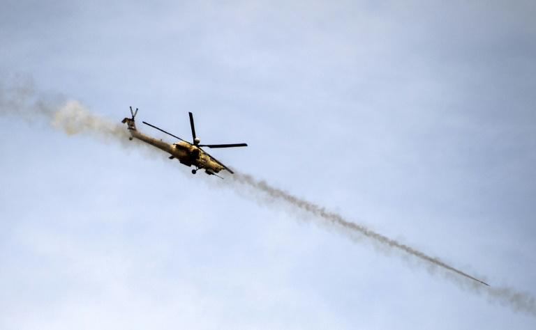 An Iraqi forces attack helicopter fires missiles on the Islamic State in May 2017
