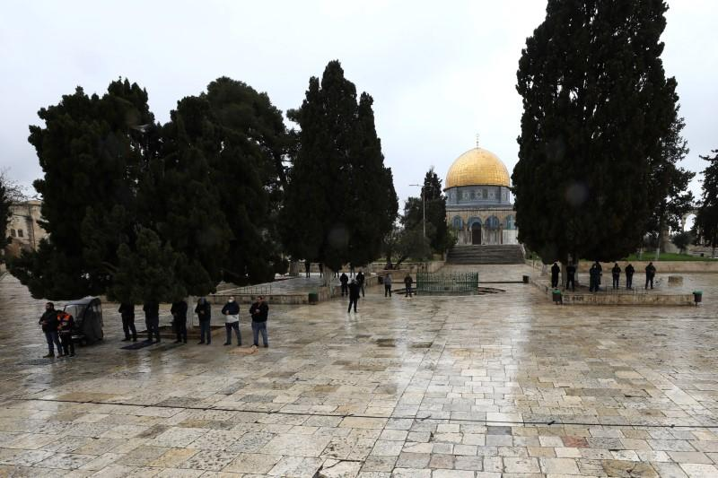 Muslim worshippers pray in small groups in front of the Dome of the Rock in the compound known to Muslims as Noble Sanctuary and to Jews as Temple Mount, in Jerusalem's Old City