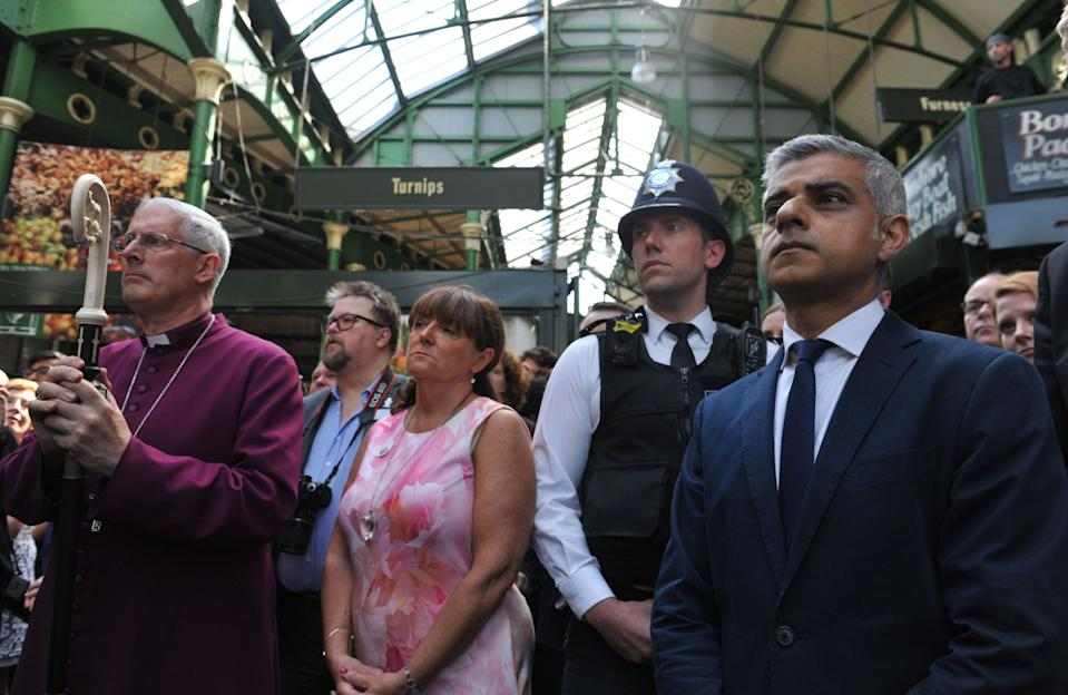 Mayor of London Sadiq Khan and the Bishop of Southwark Christopher Chssun joins traders and visitors for a minute's silence to remember the victims of the London Bridge terror attack before the market bell is rung to mark the opening of Borough Market.