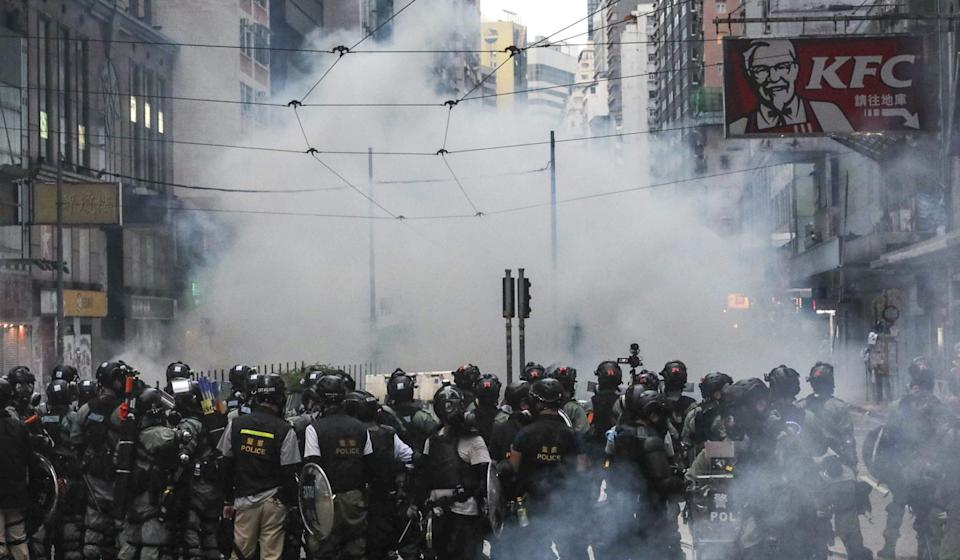Anti-government protesters react to tear gas following a rally in against anti-mask law on October 5, 2019. Photo: Felix Wong