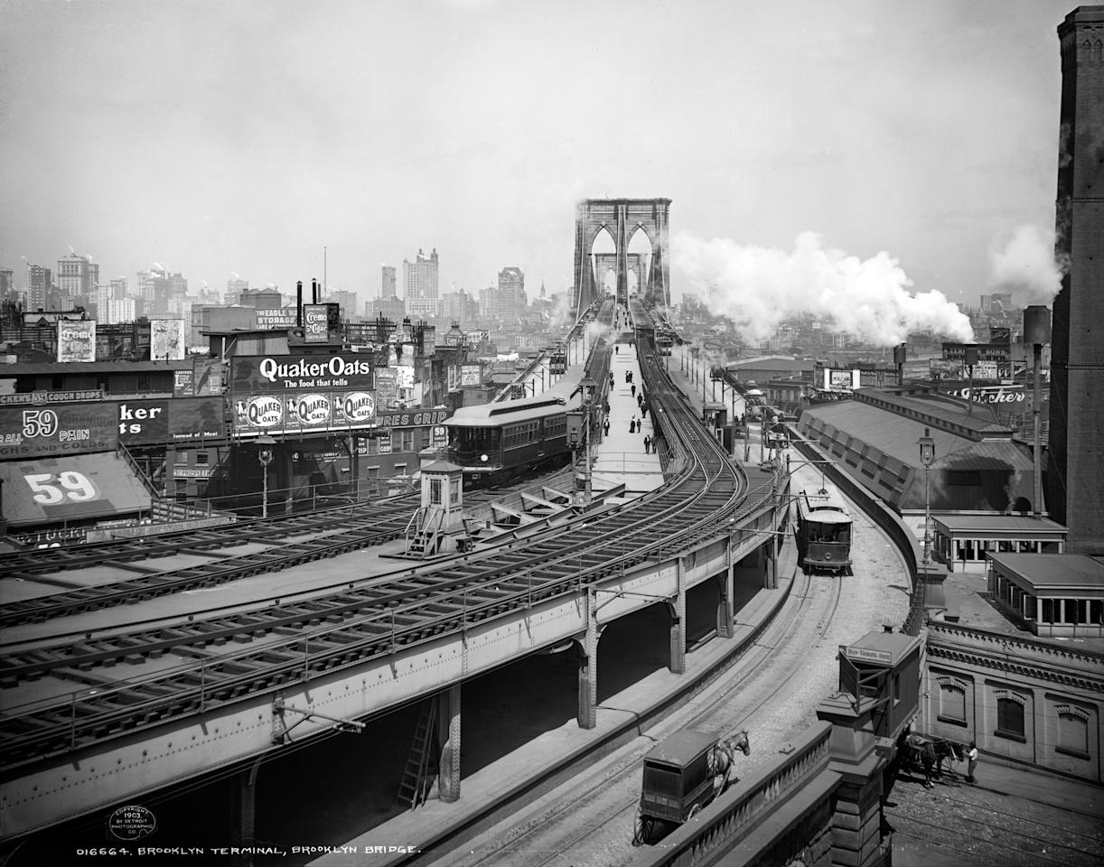 Trains and a horse-drawn carriage pass through the Brooklyn terminal of New York's Brooklyn Bridge, ca. 1903. (AP Photo/Library of Congress)