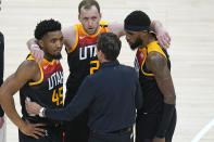 Utah Jazz coach Quin Snyder huddles with Donovan Mitchell (45), Joe Ingles (2) Royce O'Neale during the second half of Game 5 of the team's NBA basketball first-round playoff series against the Memphis Grizzlies on Wednesday, June 2, 2021, in Salt Lake City. (AP Photo/Rick Bowmer)