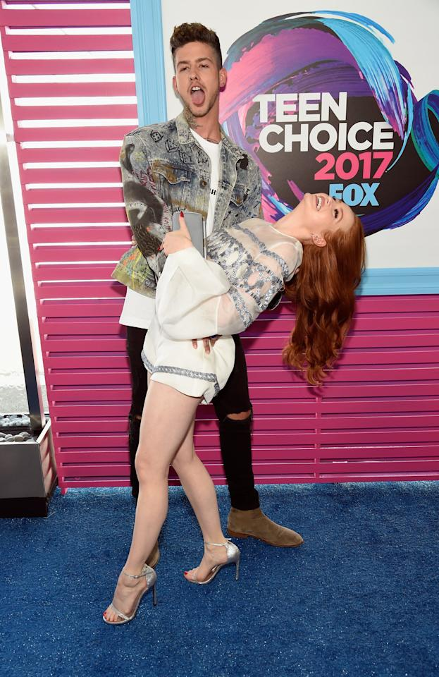 """<p>Madelaine was up for her first Teen Choice Award in 2017, and Travis was right there at her side. He must have been a good-luck charm, too - she took home the award for choice """"hissy fit""""!</p>"""