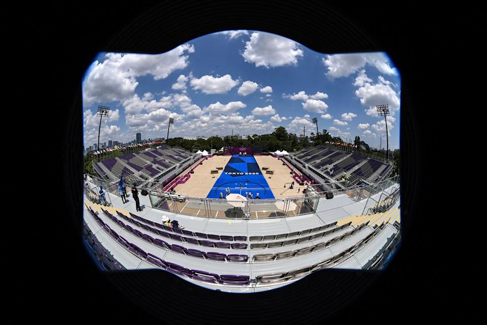 <p>This picture taken with a fisheye lens shows empty spectator seats as archers compete in the women's team eliminations during the Tokyo 2020 Olympic Games at Yumenoshima Park Archery Field in Tokyo on July 25, 2021. (Photo by ADEK BERRY / AFP)</p>