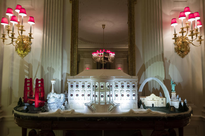The White House made of gingerbread also features landmarks from around the country in the State Dinning Room during the 2019 Christmas preview at the White House, Monday, Dec. 2, 2019, in Washington. | AP—Copyright 2019 The Associated Press. All rights reserved.
