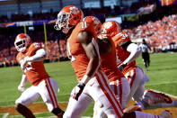 Clemson's Isaiah Simmons (11) celebrates after returning an interception for a touchdown during the first half of an NCAA college football game against Louisville, Saturday, Nov. 3, 2018, in Clemson, S.C. (AP Photo/Richard Shiro)