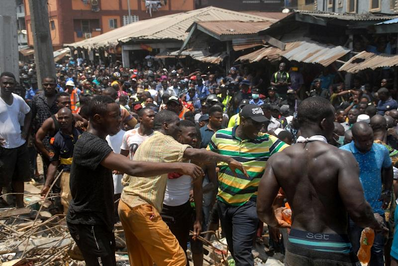 Emergency and rescue personnel have been trying to find survivors (AFP Photo/SEGUN OGUNFEYITIMI)