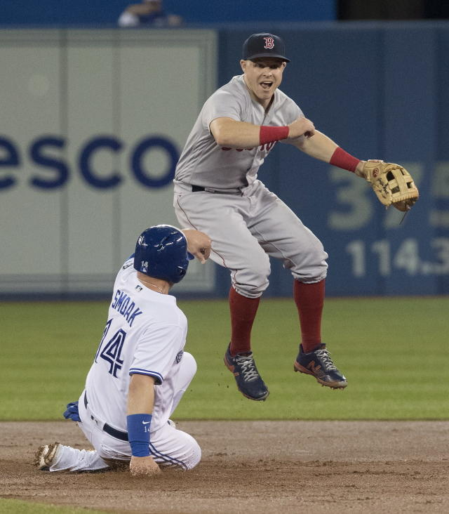 Boston Red Sox's Brock Holt gets the force out at second base on Toronto Blue Jays' Justin Smoak but fails to turn the double play during the first inning of a baseball game Thursday, Aug. 9, 2018, in Toronto. (Fred Thornhill/The Canadian Press via AP)