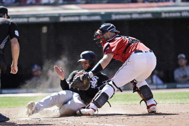 Chicago White Sox's Welington Castillo is tagged out at home plate by Cleveland Indians' catcher Kevin Plawecki in the seventh inning of a baseball game, Thursday, Sept. 5, 2019, in Cleveland. (AP Photo/Tony Dejak)