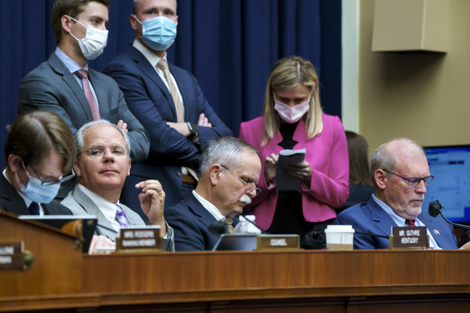 """House Energy and Commerce members, seated from left, Rep. Brett Guthrie, R-Ky., Rep. David McKinley, R-W.Va., and Rep. Morgan Griffith, R-Va., listen during votes on amendments during work on the """"Build Back Better"""" package, cornerstone of President Joe Biden's domestic agenda, at the Capitol in Washington, Wednesday, Sept. 15, 2021. (AP Photo/J. Scott Applewhite)"""