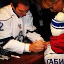Alex Ovechkin signs a young fan's jersey. (#NickInEurope)