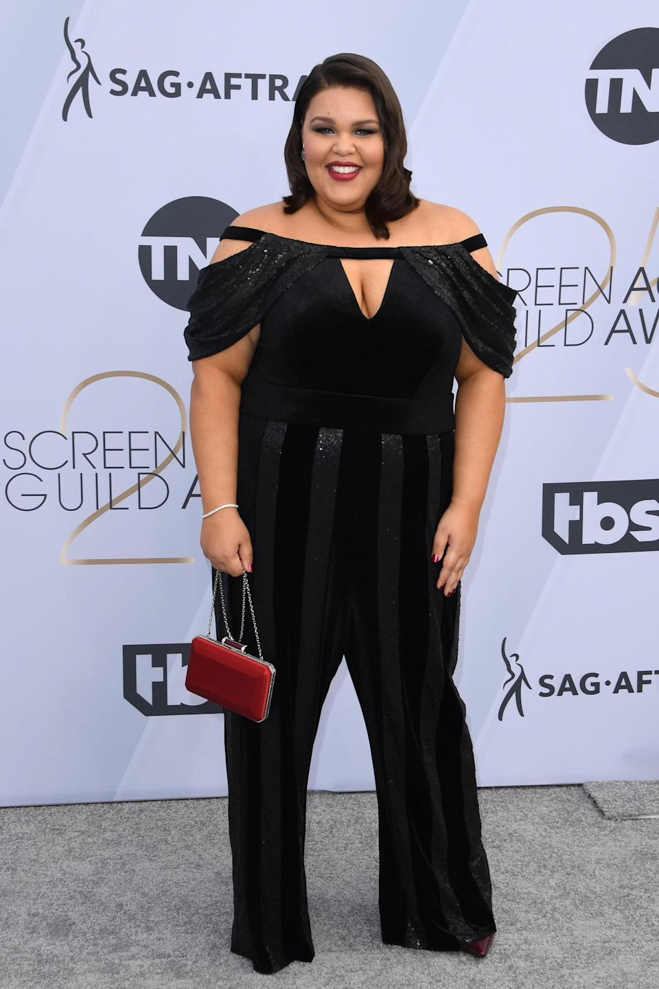 <p>Wearing a black Tadashi Shoji jumpsuit with Hearts On Fire jewelry.</p>