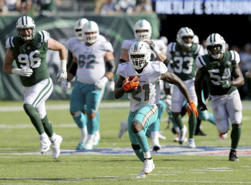 FILE - In this Sunday, Sept. 16, 2018, file photo, Miami Dolphins running back Frank Gore (21) carries the ball against the New York Jets during an NFL football game in East Rutherford, N.J. Running backs Frank Gore and Oaklands Marshawn Lynch are still going strong in their 30s. The two teams meet on Sunday. (Brad Penner/AP Images for Panini, File)