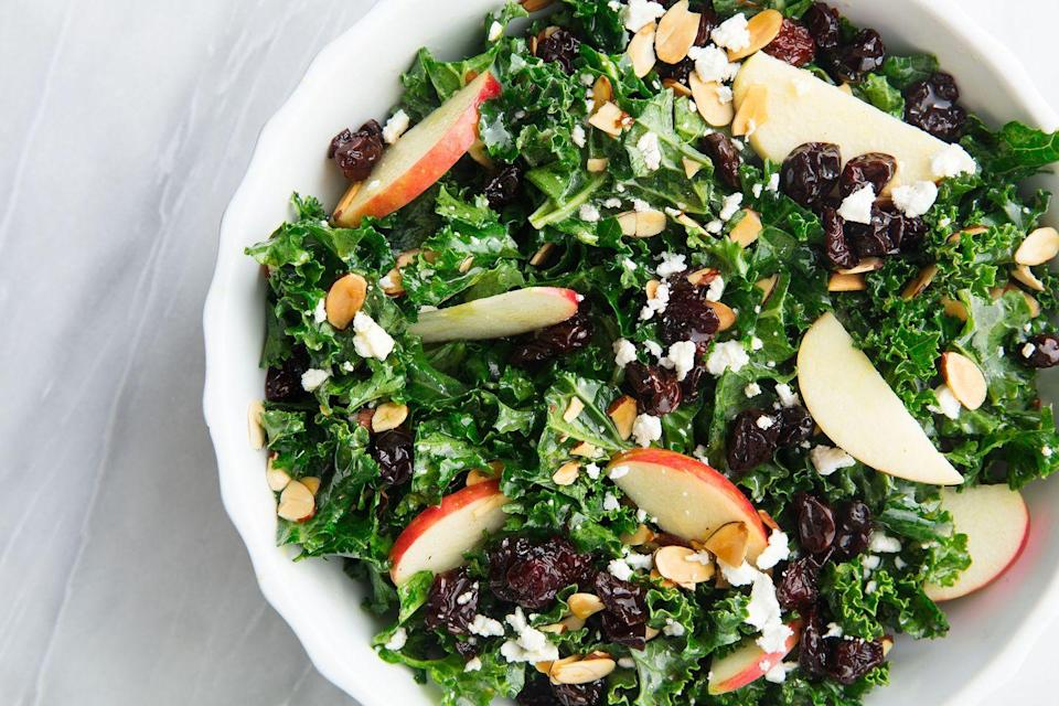 "<p>Kale is a superfood a. According to <a href=""http://www.webmd.com/food-recipes/features/the-truth-about-kale"" rel=""nofollow noopener"" target=""_blank"" data-ylk=""slk:WebMD"" class=""link rapid-noclick-resp"">WebMD</a>, this hardy green vegetable, which is a member of the cabbage family, can lower cholesterol and cancer risk. It's low in calories, like most vegetables, but is also a good source of a whole range of essential nutrients, like calcium, vitamin K, vitamin A, vitamin C, manganese, potassium, copper, and fiber.</p><p><strong>Recipe: <a href=""https://www.delish.com/cooking/recipe-ideas/a20088309/best-kale-salad-recipe/"" rel=""nofollow noopener"" target=""_blank"" data-ylk=""slk:Kale Salad With Apples And Toasted Almonds"" class=""link rapid-noclick-resp"">Kale Salad With Apples And Toasted Almonds</a></strong></p>"