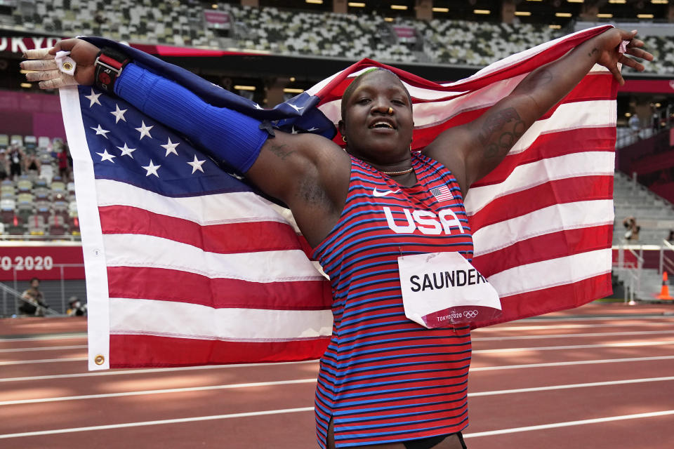 Raven Saunders, of United States, celebrates after her second place finish in the final of the women's shot put at the 2020 Summer Olympics, Sunday, Aug. 1, 2021, in Tokyo. (AP Photo/David J. Phillip)
