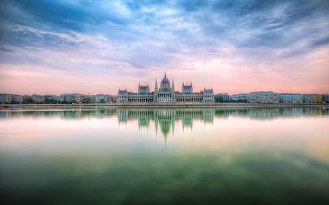 Sunrise by the Hungarian Parliament - Credit: Getty