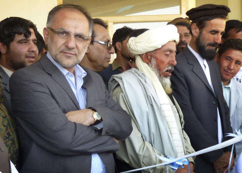In this Saturday, Oct. 12, 2013 photo, Governor Arsallah Jamal, left, attends an opening ceremony of a school in Muhammad Agha, Logar province, Afghanistan. A bomb planted inside a mosque killed the governor of Afghanistan's eastern Logar province as he was delivering a speech Tuesday morning, Oct. 15, 2013 to mark the Muslim holiday of Eid al-Adha, officials said. (AP Photo/Ahsanullah Majuze)