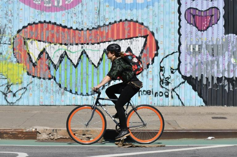 During the pandemic lockdown, bicycles have proven a godsend for New Yorkers like this woman  riding in Brooklyn