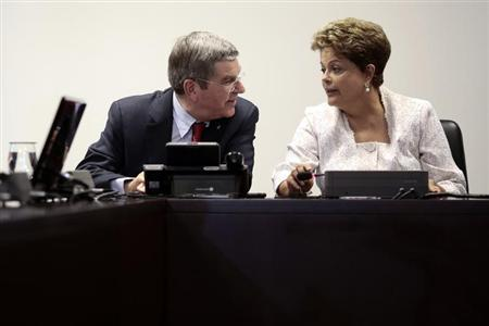 International Olympic Committee President Bach speaks with Brazil's President Rousseff during a meeting at the Planalto Palace in Brasilia