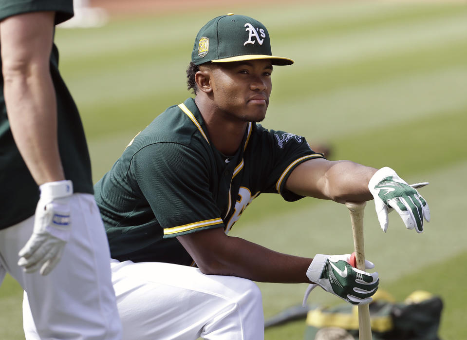 In this Friday, June 15, 2018 file photo, Oakland Athletics draft pick Kyler Murray waits to hit during batting practice before a baseball game between the Athletics and the Los Angeles Angels in Oakland, Calif. (AP Photo/Jeff Chiu, File)