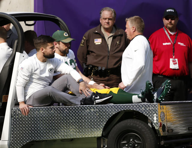 Aaron Rodgers was carted off the field in Minnesota after suffering a big hit from Vikings linebacker Aaron Barr. (AP)