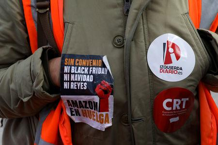 FILE PHOTO: A picket wears stickers related to the strike outside the entrance of an Amazon fulfillment centre in San Fernando de Henares near Madrid, Spain, November 23, 2018.   REUTERS/Susana Vera /File Photo
