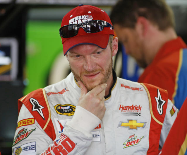 <p> Dale Earnhardt Jr. looks over his car during practice for Sunday's NASCAR Sprint Cup series Coca-Cola 600 auto race at Charlotte Motor Speedway in Concord, N.C., Saturday, May 24, 2014. (AP Photo/Chris Keane) </p>