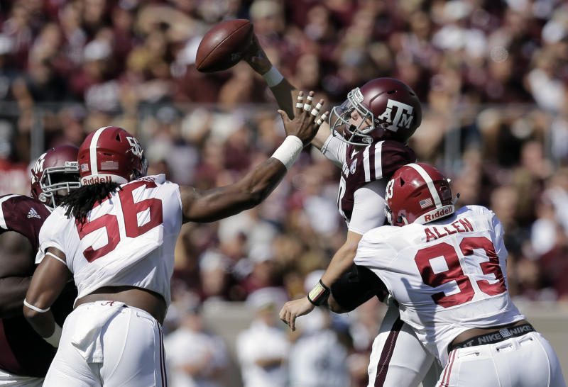 Texas A&M quarterback Kyle Allen, center, is pressured by Alabama 's Tim Williams (56) and Jonathan Allen (93) as he tries to pass during the first half of an NCAA college football game, Saturday, Oct. 17, 2015, in College Station, Texas. (AP Photo/Eric Gay)