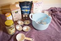 <p>To make the bath bombs, you'll need the following ingredients:</p> <ul> <li>1 cup baking soda</li> <li>1/2 cup corn starch</li> <li>1/2 cup citric acid</li> <li>3 tablespoons Epsom salt</li> <li>1 tablespoon coconut oil</li> <li>Lavender essential oil</li> <li>Frankincense essential oil</li> <li>Witch hazel essential oil</li> <li>Bath bomb molds</li> </ul> <p>I also added dried flowers to my bath bombs because I thought it would be pretty, and while they looked pretty, I wouldn't recommend actually doing this. Not only can they be problematic in your tub drain but you'll end up with flower pieces stuck to you . . . everywhere.</p>