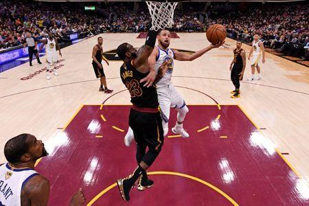 Jun 8, 2018; Cleveland, OH, USA; Golden State Warriors guard Stephen Curry (30) shoots the ball against Cleveland Cavaliers forward LeBron James (23) in game four of the 2018 NBA Finals at Quicken Loans Arena. Mandatory Credit: Gregory Shamus/pool photo-USA TODAY Sports