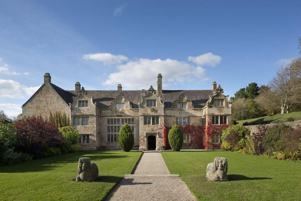 """<p>Enjoy a traditional Cornish cream tea at this Elizabethan manor house near Newquay, where you can bask in the sun and enjoy some peace and quiet in the pretty knot garden. </p><p>Inside you'll find fascinating historical objects such as wooden skittles and a 300-year-old longcase clock, as well as the Great Hall window – which is still intact with 576 panes of 16th-century glass.</p><p><strong>Where to stay:</strong> After a lazy afternoon in the house and gardens, round your trip off with a luxurious stay at Newquay's <a href=""""https://go.redirectingat.com?id=127X1599956&url=https%3A%2F%2Fwww.booking.com%2Fhotel%2Fgb%2Fthe-headland.en-gb.html%3Faid%3D2070935%26label%3Dnational-trust-cornwall&sref=https%3A%2F%2Fwww.countryliving.com%2Fuk%2Ftravel-ideas%2Fstaycation-uk%2Fg35461727%2Fnational-trust-cornwall%2F"""" rel=""""nofollow noopener"""" target=""""_blank"""" data-ylk=""""slk:Headland Hotel"""" class=""""link rapid-noclick-resp"""">Headland Hotel</a>, a magnificent red-brick property overlooking Fistral Beach. You'll be treated to an indulgent spa, elegant modern rooms and a choice of two award-winning restaurants. </p><p><a href=""""https://www.countrylivingholidays.com/offers/cornwall-newquay-headland-hotel"""" rel=""""nofollow noopener"""" target=""""_blank"""" data-ylk=""""slk:Read our hotel review of The Headland Hotel & Spa"""" class=""""link rapid-noclick-resp"""">Read our hotel review of The Headland Hotel & Spa</a></p><p><a class=""""link rapid-noclick-resp"""" href=""""https://go.redirectingat.com?id=127X1599956&url=https%3A%2F%2Fwww.booking.com%2Fhotel%2Fgb%2Fthe-headland.en-gb.html%3Faid%3D2070935%26label%3Dnational-trust-cornwall&sref=https%3A%2F%2Fwww.countryliving.com%2Fuk%2Ftravel-ideas%2Fstaycation-uk%2Fg35461727%2Fnational-trust-cornwall%2F"""" rel=""""nofollow noopener"""" target=""""_blank"""" data-ylk=""""slk:CHECK PRICES"""">CHECK PRICES</a></p>"""