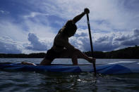 Canoe sprint world champion Nevin Harrison, 19, of Seattle, trains near Lake Lanier Olympic Park on Thursday, July 1, 2021, in Gainesville, Ga. Harrison won the world championship in the women's sprint canoe 200 meters as a 17-year-old in 2019. Now she'll try to duplicate that at the Olympics in Tokyo where the race will be a new event in a bid for gender equity. (AP Photo/Brynn Anderson)