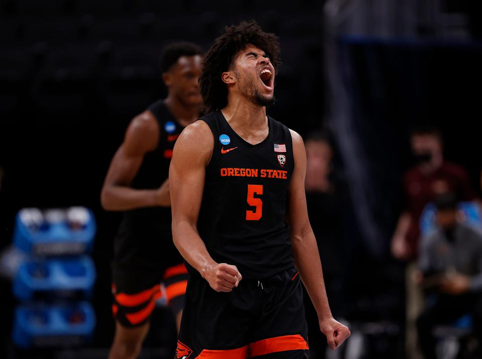 Ethan Thompson of the Oregon State Beavers celebrates against the Loyola-Chicago Ramblers during the first half in the Sweet Sixteen round of the 2021 NCAA Men's Basketball Tournament at Bankers Life Fieldhouse on March 27, 2021 in Indianapolis, Indiana.