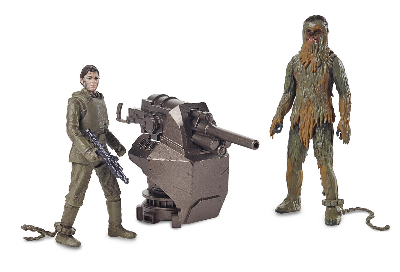 "<p>Why are Han and Chewie so muddy? We're guessing it's because we're catching them mid-jailbreak, which also explains the chains on their ankles and Chewie's missing bandolier. This suggests that <em>Solo </em>will be borrowing <a rel=""nofollow"" href=""https://www.hollywoodreporter.com/heat-vision/solo-a-star-wars-story-reveal-how-han-chewbacca-met-1075042"">a discarded piece of Expanded Universe mythology</a>, in which the pilot helped an enslaved Chewbacca escape the Empire and earned the Wookiee's life debt in the process. (Photo: Hasbro) </p>"