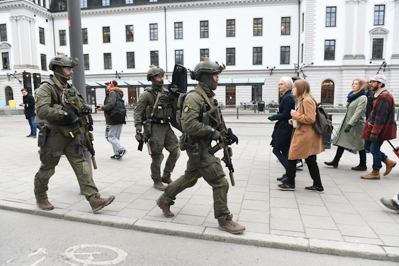 Police patrolling outside Stockholm Central station yesterday: Getty