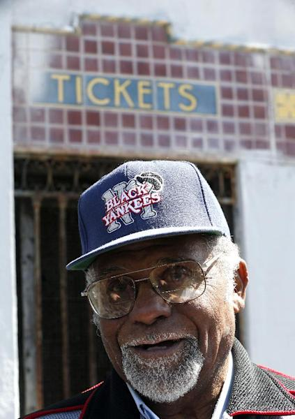 """Robert """"Bob"""" Scott, who once played for the New York Black Yankees of the Negro League baseball league stands outside of Hinchliffe Stadium, Wednesday, April 16, 2014, in Paterson, N.J. Hinchliffe Stadium in Paterson was once home to the New York Black Yankees, the New York Cubans and other Negro League baseball teams. Eleven members of the National Baseball Hall of Fame played there, including Larry Doby. The crumbling Art Deco stadium was granted national historic landmark status in 2013. Lawmakers are pushing to designate it as part of the nearby Great Falls National Historical Park. (AP Photo/Julio Cortez)"""