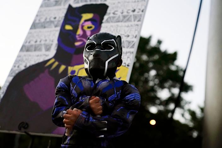 Mason Wilkes, 4, of South Carolina, poses for his father in a Black Panther costume, in front of a painting during a Chadwick Boseman Tribute on Thursday, Sept. 3, 2020, in Anderson, S.C. Boseman died of cancer on August 28 at the age of 43.