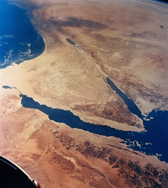 FILE -- This undated file photo released by NASA, taken from 175 miles up by Gemini II, shows the Sinai Peninsula, center, in Egypt. Egyptian intelligence officials say they are negotiating with Bedouin gunmen to free two tourists, an Israeli man and a Norwegian woman, kidnapped Friday, March 22, 2013 along a main road in Egypt's southern Sinai Peninsula. (AP Photo/NASA, File)
