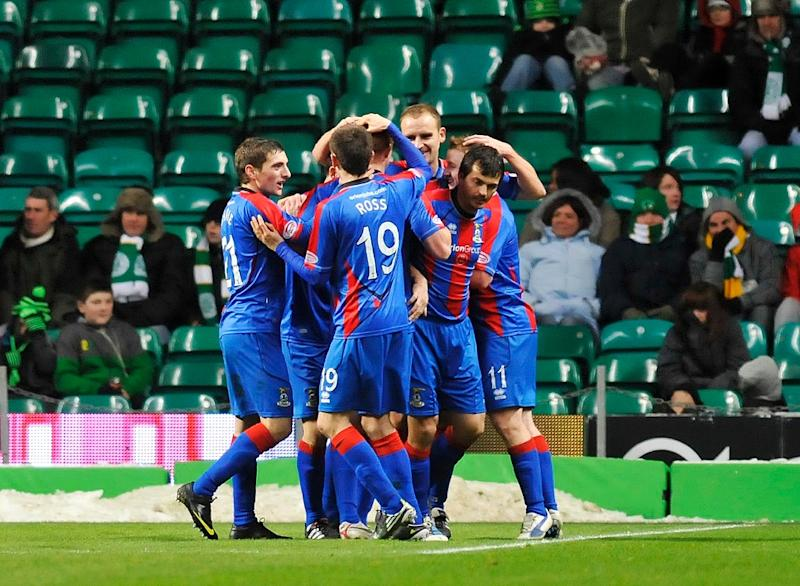 Inverness players celebrate scoring a goal during a football match in Glasgow, Scotland, on November 27, 2010