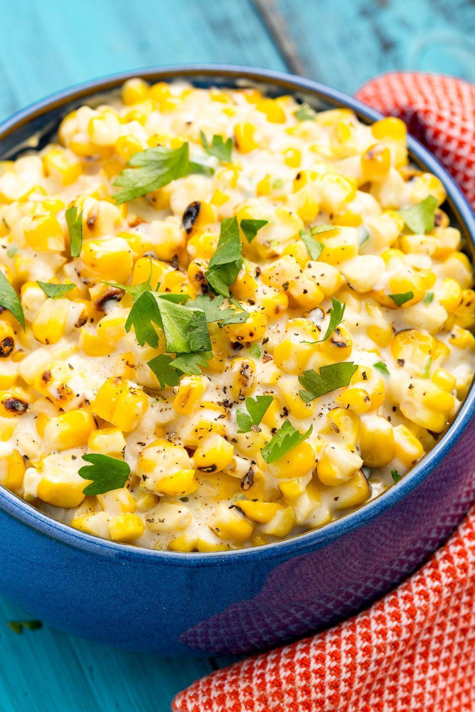 """<p>Our take on this classic side packs a punch with charred, fresh corn and jalapeño.</p><p>Get the recipe from <a href=""""https://www.delish.com/cooking/recipe-ideas/recipes/a47386/grilled-creamed-corn-recipe/"""" rel=""""nofollow noopener"""" target=""""_blank"""" data-ylk=""""slk:Delish"""" class=""""link rapid-noclick-resp"""">Delish</a>.</p>"""