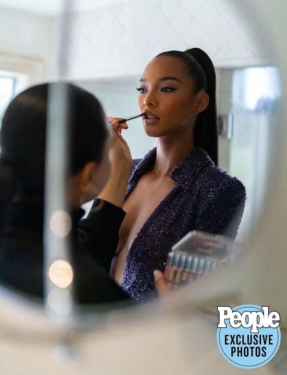 <p>Final touches before you see my full look.</p>