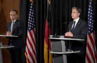 US Secretary of State, Antony Blinken, right, and German Foreign Minister Heiko Maas, left, address the media during a joint press conference after a meeting at the Ramstein U.S. Air Base in Ramstein, Germany, Wednesday, Sept. 8, 2021. The largest American military community overseas houses thousands Afghan evacuees in a tent city at the airbase. (AP Photo/Michael Probst)