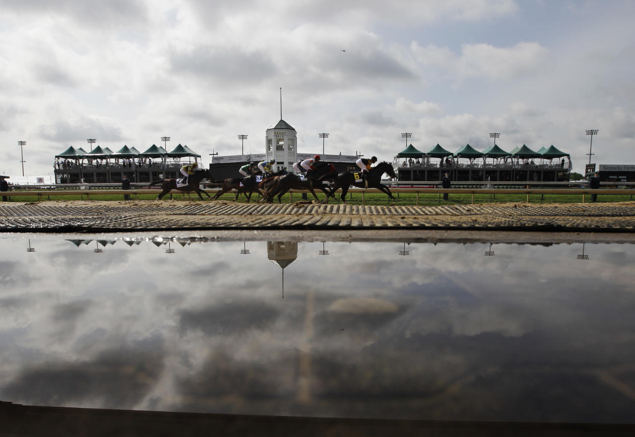 Water covers the ground on the outside of the track after heavy overnight rain during the first race of the day before the 138th Kentucky Derby horse race at Churchill Downs Saturday, May 5, 2012, in Louisville, Ky. (AP Photo/Matt Slocum)