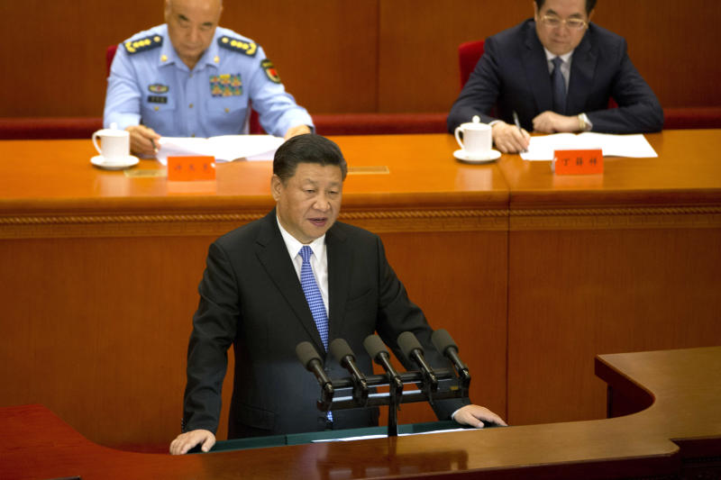 """Chinese President Xi Jinping speaks at an event to mark the bicentennial of Marx's birth held at the Great Hall of the People in Beijing Friday, May 4, 2018. Xi praised Karl Marx as """"the greatest thinker of modern times,"""" calling his theories a tool for China to """"win the future."""" (AP Photo/Ng Han Guan)"""