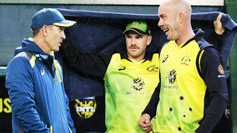 Justin Langer, pictured here talking with Chris Lynn during the International Twenty20 match between Australia and India in 2018.