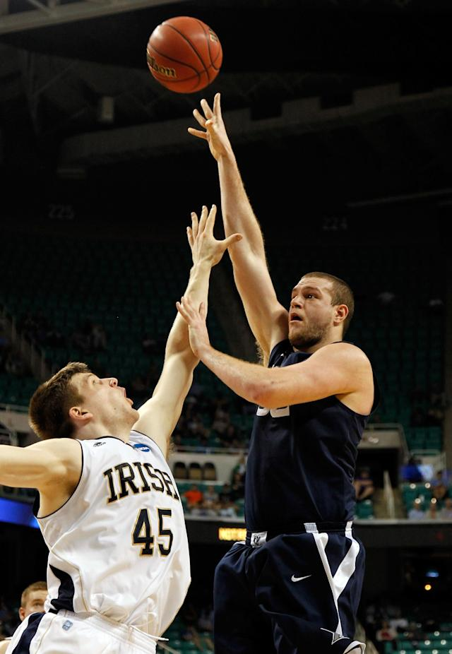 GREENSBORO, NC - MARCH 16: Kenny Frease #32 of the Xavier Musketeers shoots over Jack Cooley #45 of the Notre Dame Fighting Irish in the first half during the second round of the 2012 NCAA Men's Basketball Tournament at Greensboro Coliseum on March 16, 2012 in Greensboro, North Carolina. (Photo by Mike Ehrmann/Getty Images)