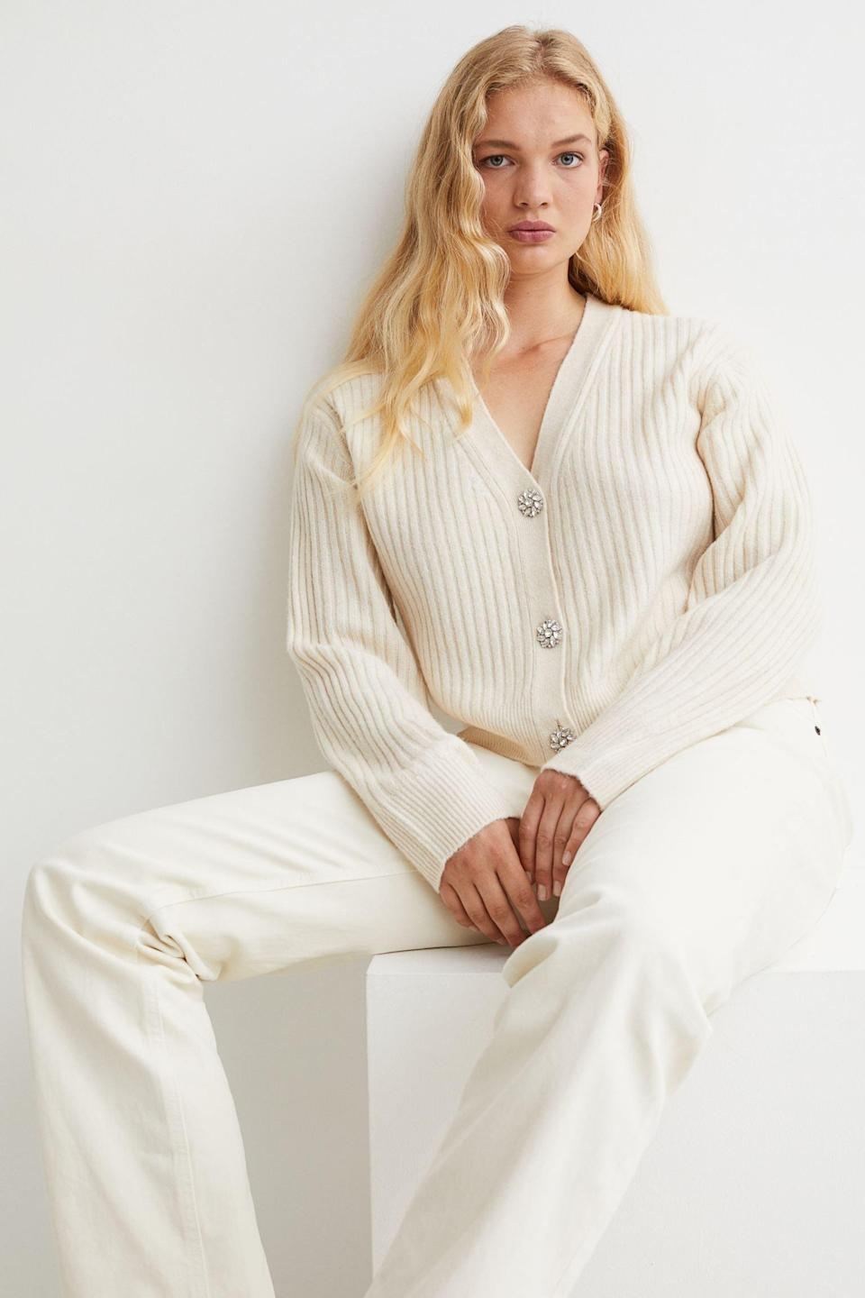 <p>The embellished buttons of this <span>Rib-Knit Cardigan</span> ($16, originally $20) make it a step above the rest. Pair it with white jeans for a crisp monochrome look.</p>